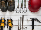 ice climbing and travel equipment on wooden background