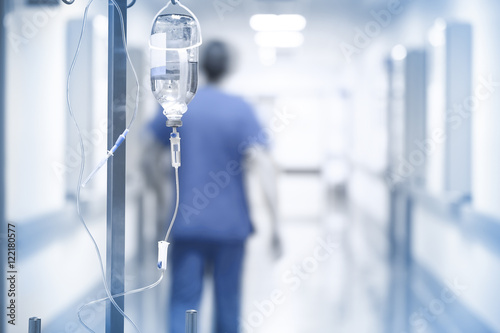 Drip on the background of doctor walking down the hall Poster