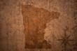 minnesota state map on a old vintage crack paper background