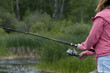 Mid section view of a girl fishing, Riding Mountain National Par