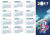 Christmas cock rolls on sledge from mountain. Blue cartoon Rooster symbol 2017 and wall calendar