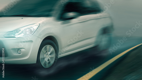Foto op Canvas Stadion Speed driving car in bad weather condition