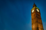 Fototapeta Big Ben - Closeup of Big Ben against the dark blue sky at night with copy space in Westminster, London, England, UK © Victor Moussa