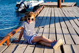 young girl sitting on the dock