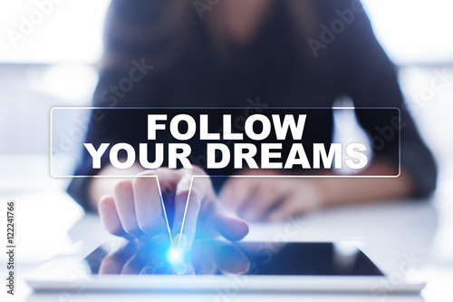"Poster Woman is using tablet pc, pressing on virtual screen and selecting ""Follow your dreams"""