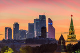 Moscow city business center and towers of Moscow Kremlin at pink sunset