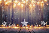 Vintage Christmas Decoration With Stars And Lights On Wooden Table  - 122291307