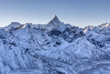 Ama Dablam mountain landscape. Sharp mountain peak standing out among Himalayan mountain range. Amazing mountain range scenery on the way to Everest Base Camp Trek.