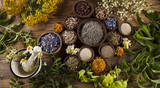 Fototapety Alternative medicine, dried herbs and mortar on wooden desk back