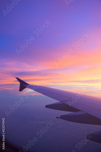 Sunset sky from the airplane window - 122374342