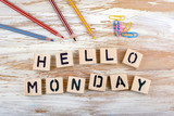 Text: Hello Monday from wooden letterson on wooden background