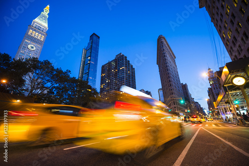 Keuken foto achterwand New York TAXI Defocus motion blur view of yellow taxis driving through the city streets at dusk in New York City, USA