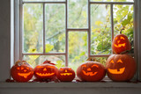 halloween pumpkins on window