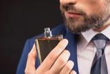 Successful businessman likes perfume scent
