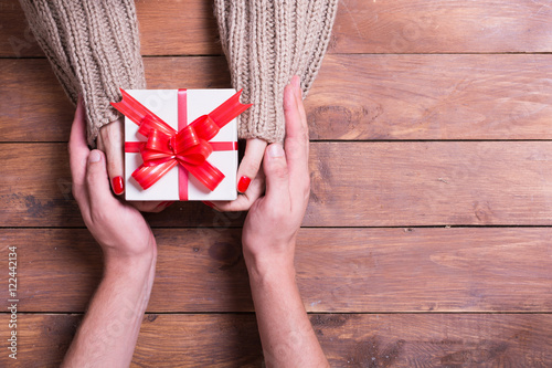 Woman with man holding a christmas gift