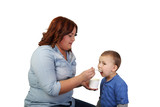 Woman feeds little boy isolated on white background