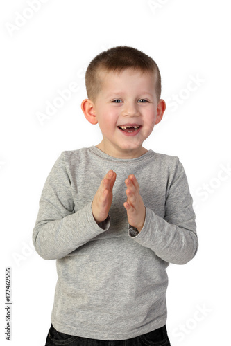 Poster Little toothless boy with wide happy smile on face joyfully clapping hands