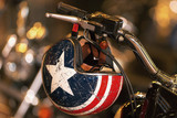 Fototapety Helmet with the lone star hanging from the handlebar from a motorbike