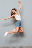 Cheerful pretty young girl jumping