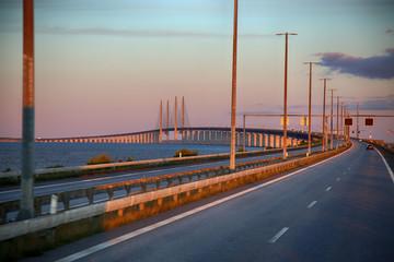 View on Oresund bridge between Sweden and Denmark at sunset