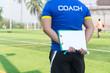 Coach is coaching Children Training In Soccer Team
