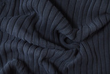 A full page of navy blue knitwear fabric background texture