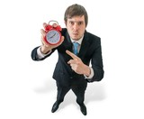 Deadline concept. Angry boss is showing clock. Isolated on white background.