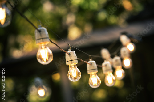 Foto Murales outdoor string lights hanging on a line in backyard