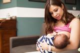 Pretty mom breastfeeding her baby