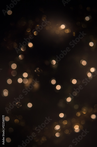 Billede Glitter vintage lights background. dark gold and black. defocused