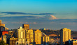 Mt. Rainier rises over Seattle near dusk