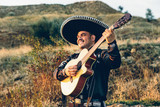 Fototapety Mexican, Latin American, Spanish. Musician on the coast.