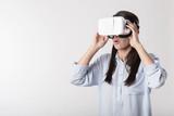 Joyful woman using virtual reality device