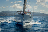View on the bow of sailing yacht wich is cruising near Porto Cervo, Sardinia.