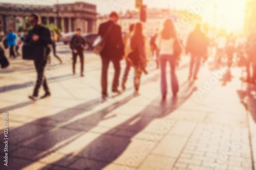fototapeta na ścianę People walking on the street. Blurred effect.