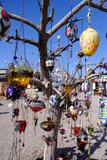 Evil eye charms hang from a tree in Cappadocia, Turkey