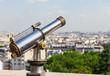 Touristic telescope overlooking Paris from Montmartre hill. Pari