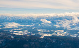 View of dolomites alps covered with snow from the gerlitzen mountain near villach.