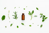 Bottle of essential oil with fresh herbal sage, rosemary, lemon - 122700322