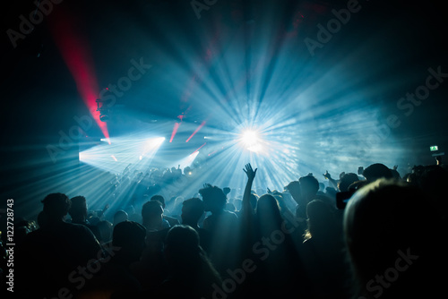 Hands in the air in a club with house music