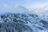 Winter day in Polish Tatra mountains, frozen Morskie Oko lake an