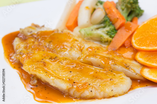 Poster Dory fish steak with orange sauce