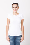 T-shirt design and people concept - close up of young woman in blank white t-shirt. Clean shirt mock up for design