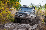 Japaneese SUV moving fast by deep mud