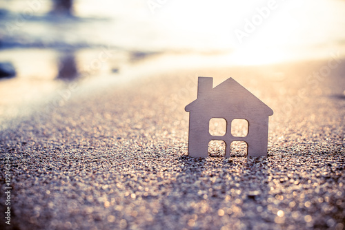 symbol of the house at sunset on the seashore