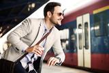 Businessman on railroad station