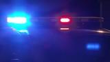 Police lights flashing close up at night at crime scene.