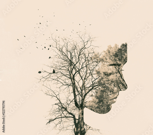 Double exposure portrait of young woman and autumn trees. - 122793796