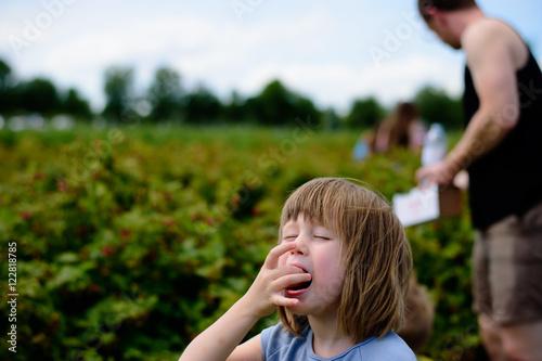 Poster girl eats berries