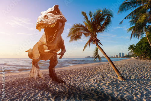 Dinosaur model on the beach in the morning